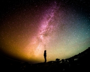 Galaxy with silhouette of person.